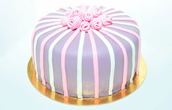 Fondant cake with roses on white. Pink, white and violet roses fondant cake stock images