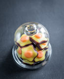 Fondant candies under the glass dome Stock Photography
