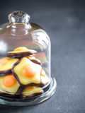 Fondant candies under the glass dome Stock Photo