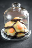 Fondant candies under the glass dome Royalty Free Stock Photos