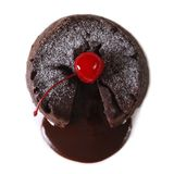 Fondant chocolate cake with cherry closeup isolated on white Royalty Free Stock Photo