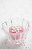 Fondant-covered petit four in glass bowl Royalty Free Stock Photography