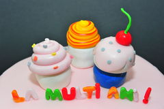 Fondant Cupcakes figurines for birthday cakes Stock Photography