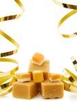 Fondant de caramel avec les bandes de fête Image stock