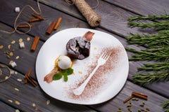 Fondant dessert. Beautifully decorated dish. Fondant dessert with hot chocolate inside royalty free stock photography