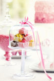 Fondant fancies. On a dessert table royalty free stock photos