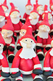 Fondant Santas. Santa Clause made of fondant sitting together Royalty Free Stock Image