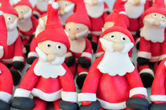 Fondant Santas. Santa Clauses made of fondant sitting together used for decorating cakes Stock Image