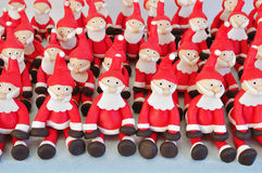Fondant Santas. Several Santa Clause made of fondant sitting together Royalty Free Stock Images