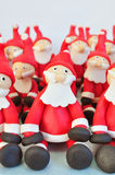 Fondant Santas. Several Santa Clause made of fondant sitting together Stock Photography