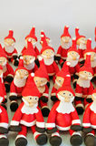 Fondant Santas. Several Santa Clause made of fondant sitting together Stock Image