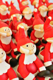 Fondant Santas. Several Santa Clause made of fondant sitting together Stock Photo