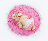 Fondant sleeping baby girl for decoration christening or birthda. Y cake isolated on white background Royalty Free Stock Photos