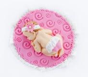 Fondant sleeping baby girl for decoration christening or birthda. Y cake isolated on white background royalty free stock photos