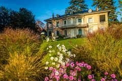 Fondation de Hermitage in Lausanne. With flowers at sunset Royalty Free Stock Photography