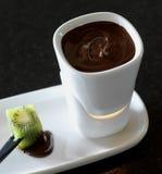 Fondie of chocolate. Fondie of warm chocolate with kiwi Royalty Free Stock Image