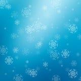 Fondo abstracto azul con los copos de nieve Foto de archivo libre de regalías