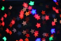 Fondo abstracto borroso bokeh colorido de la estrella Concepto del partido de la Navidad y del Año Nuevo Imágenes de archivo libres de regalías