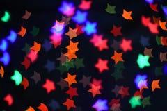 Fondo abstracto borroso bokeh colorido de la estrella Concepto del partido de la Navidad y del Año Nuevo Foto de archivo libre de regalías