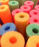 Fondo abstracto coloreado de los tallarines de la piscina de la espuma imagen de archivo