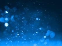 Fondo abstracto con el bokeh de la burbuja en color azul Imágenes de archivo libres de regalías
