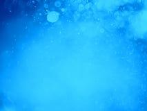 Fondo abstracto con el bokeh de la burbuja en color azul Imagenes de archivo