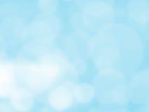 Fondo abstracto con el bokeh de la burbuja en color azul Imagen de archivo libre de regalías