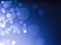 Fondo abstracto con el bokeh de la burbuja en color azul Fotos de archivo libres de regalías