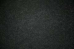 Fondo abstracto con el grano negro, textura que pone en contraste imagen de archivo