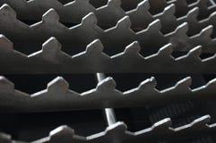 Fondo abstracto con el modelo de los dientes del metal Imagenes de archivo