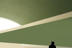 Fondo abstracto con la silueta de un hombre en sombrero Imagenes de archivo
