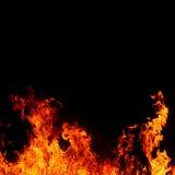 Fondo abstracto con las llamas calientes vivas del fuego Fotografía de archivo libre de regalías