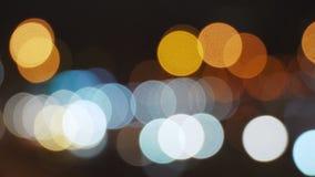 Fondo abstracto con las luces coloridas del bokeh almacen de metraje de vídeo