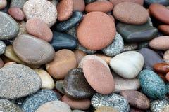 Fondo abstracto con las piedras peeble redondas Imágenes de archivo libres de regalías