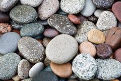 Fondo abstracto con las piedras peeble redondas Fotos de archivo libres de regalías