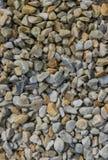Fondo abstracto con las piedras reeble redondas secas imagen de archivo