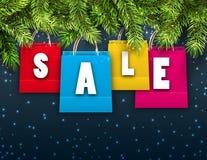 Fondo abstracto con los bolsos de la venta de las compras de la Navidad imágenes de archivo libres de regalías