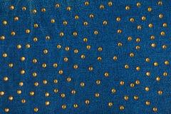 Fondo abstracto con los diamantes artificiales amarillos en el dril de algodón Imágenes de archivo libres de regalías