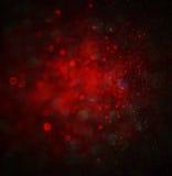 Fondo abstracto de las luces del bokeh del brillo del rojo y del oro, defocused Fotos de archivo