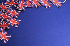 Fondo abstracto de Unioun BRITÁNICO Jack Great Britian, banderas blancas y azules, nacionales rojas del palillo con el espacio de Fotografía de archivo libre de regalías