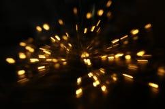 fondo abstracto del bokeh de la explosión de oro de la luz hecha del movimiento del bokeh imagen de archivo