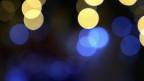 Fondo abstracto del bokeh ligero de oro de la Navidad Año Nuevo almacen de video