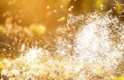 Fondo abstracto del día de fiesta con los fuegos artificiales y las estrellas Imagenes de archivo
