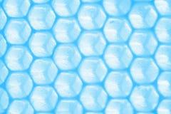Fondo abstracto del modelo del panal en tonos azules Foto de archivo