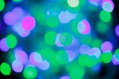 Fondo abstracto elegante de la Navidad festiva azul y verde con las luces y las estrellas del bokeh foto de archivo