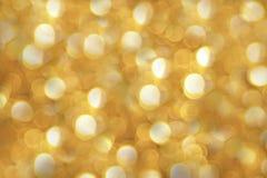 Fondo abstracto hermoso de oro del bokeh Foto de archivo