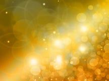 Fondo abstracto - luces brillantes en oscuridad, oro brillante Foto de archivo