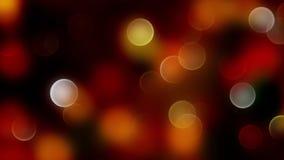 Fondo abstracto rojo del bokeh de la mezcla del oro con las luces defocused Fotos de archivo