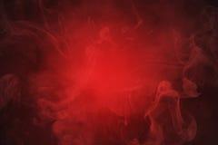 Fondo abstracto rojo del humo