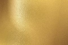Fondo abstracto, textura de acero cepillada de la pared del oro fotografía de archivo